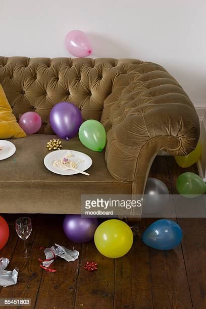 balloons scattered around sofa - leftovers stock pictures, royalty-free photos & images