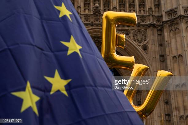 Balloons spell EU by a European flag fly outside the Houses of Parliament in Westminster on December 10 2018 in London England The Prime Minister is...