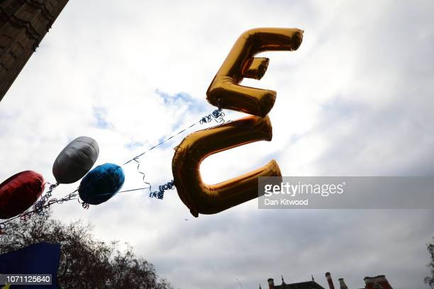 Balloons spell EU fly outside the Houses of Parliament in Westminster on December 10 2018 in London England The Prime Minister is holding meetings...