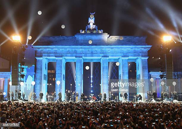 Balloons that are part of a light installation rise into the air to symbolize the collapse of the Berlin Wall in front of the Brandenburg Gate during...