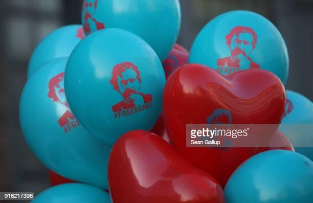 Balloons that read 'Free Deniz' in reference to Deniz Yucel a GermanTurkish journalist imprisoned in Turkey decorate a car that will drive in a...