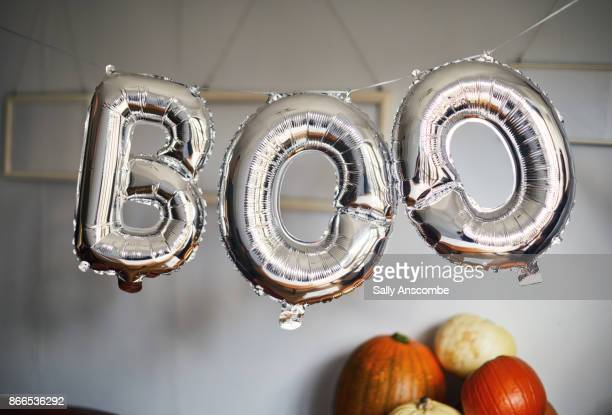 balloons that spell boo - happy halloween stock photos and pictures