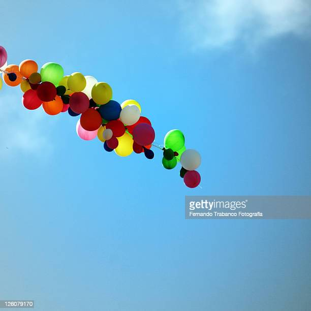Balloons under blue sky