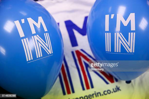 Balloons with a campaign logo sit on a tshirt at the Britain Stronger In Europe campaign offices in London UK on Thursday March 10 2016 The Britain...
