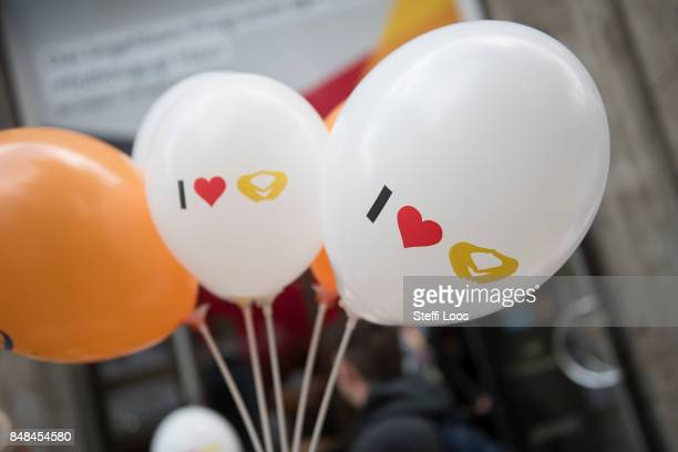 Balloons with Merkel rhombus in front of Christian Democrat Union election program house on September 17 2017 in Berlin Germany German Chancellor and...