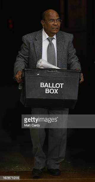 A ballot box containing votes for the Eastleigh byelection is carried into the Fleming Park Leisure Centre on February 28 2013 in Eastleigh Hampshire...
