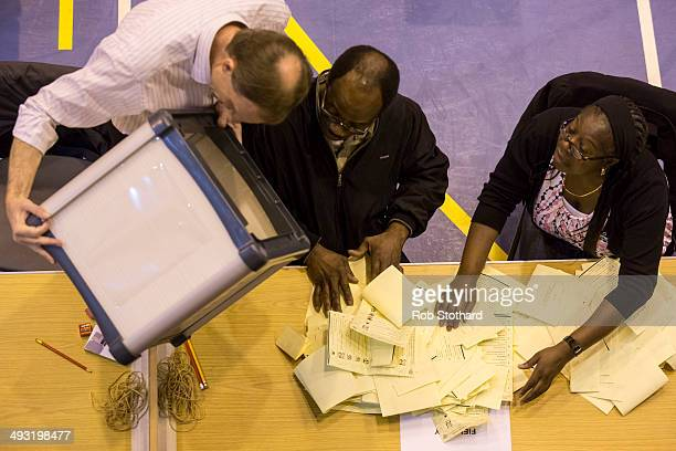 A ballot box containing votes in local elections is emptied at Trinity School on May 22 2014 in Croydon England Voters across Europe have been taking...