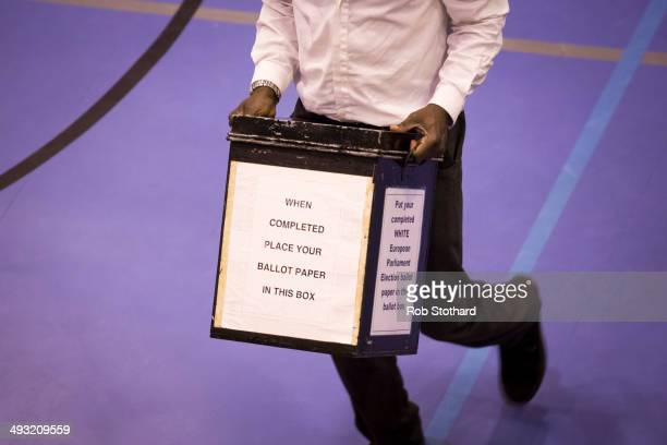A ballot box containing votes in the European elections arrives at Trinity School on May 22 2014 in Croydon England Voters across Europe have been...