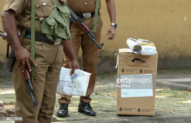 Ballot box is watched by Sri Lankan police officers outside one of the main Election material distribution centers in Colombo, Sri Lanka. November...