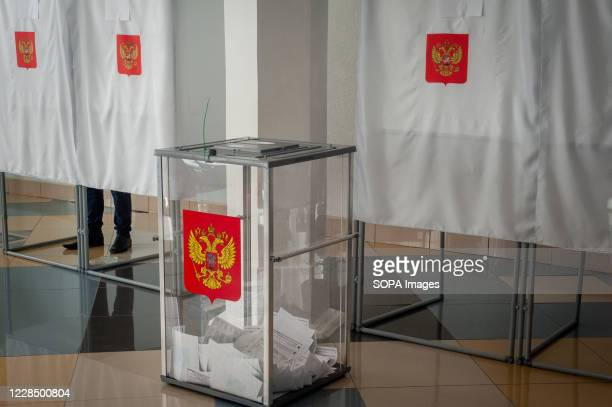 Ballot box with the coat of arms of the Russian Federation with ballots seen at a polling station. In 2020, elections in Russia will be held for...