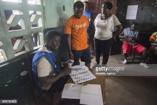 Ballot boxes are being prepared by a returning officer at Sr Kathleen McGuire Memorial Catholic School in Monrovia Liberia on October 10 2017...