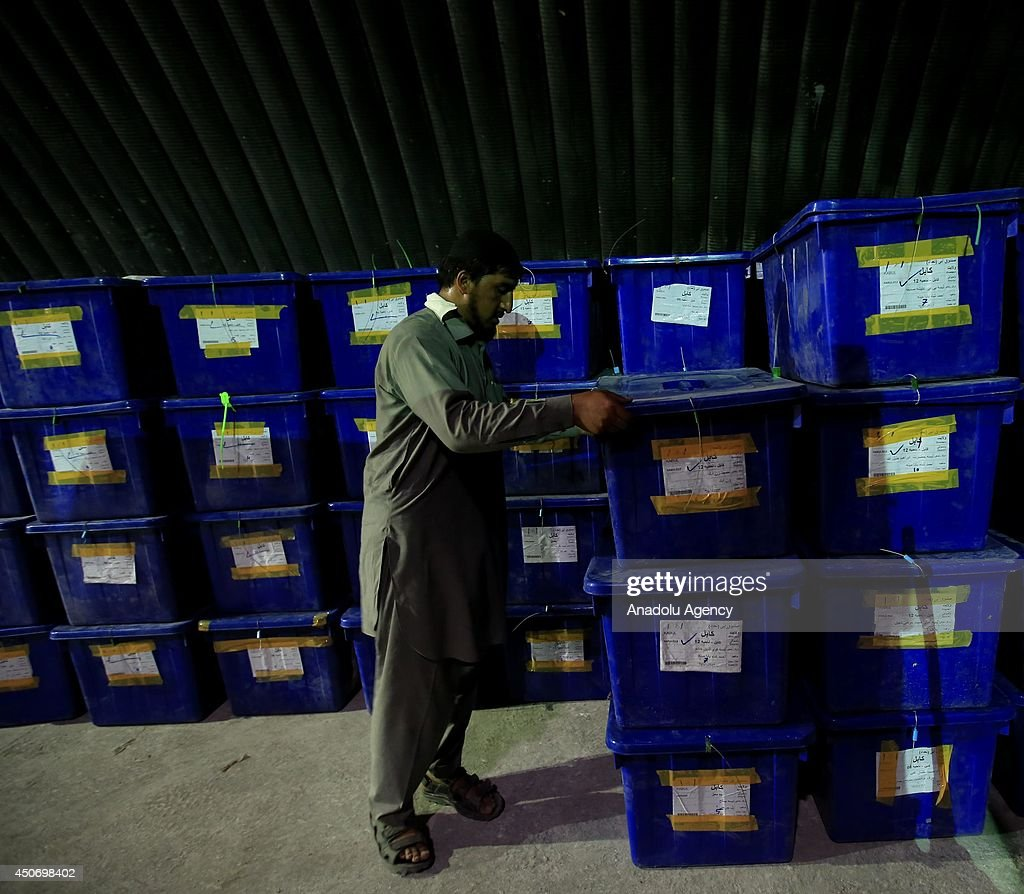 Ballot boxes are brought to election commission and counting of the votes is about to start of presidential election in Kabul, Afghanistan on 16 June, 2014.