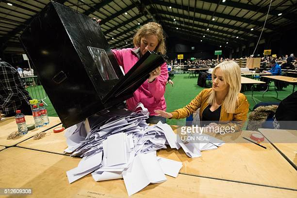 Ballot boxes are emptied onto tables as the count gets under way at the RDS centre in Dublin Ireland on February 27 2016 the day after the vote took...