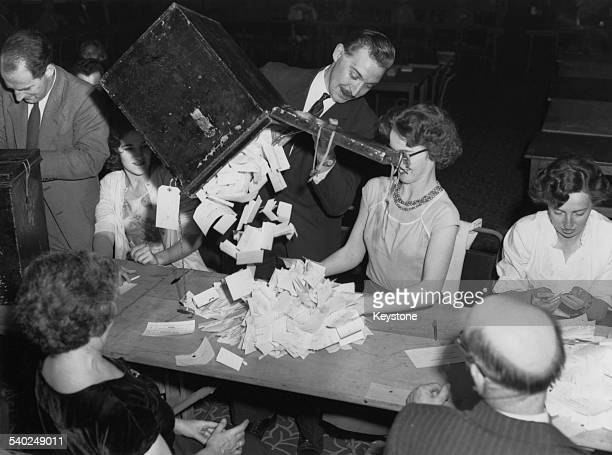 Ballot boxes are emptied ready for counting at St. Pancras Town Hall for the General Election, London, 9th October 1959.