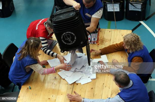 Ballot boxes are opened at the MidUlster count for the Northern Ireland Assemby elections in Ballymena Co Antrim Northern Ireland on March 3 2017...