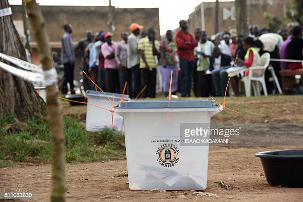 TOPSHOT Ballot boxes are pictured as people line up to cast their vote in presidential and parliamentary polls on February 18 2016 at the Nasuti...
