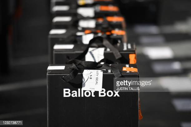 Ballot boxes are seen ahead of the count for the local elections at the count centre at Olympia London in west London on May 7, 2021. - Britain went...