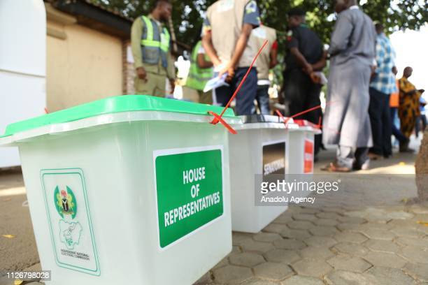 Ballot boxes are seen as voters queue at a polling station to vote in the presidential election in Abuja's Maitama District on February 23 2019
