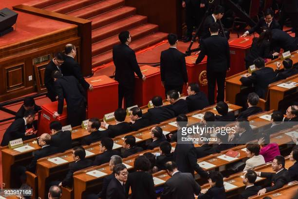 Ballot boxes are taken away after the vote during the seventh plenary session of the 13th National People's Congress at the Great Hall of the People...