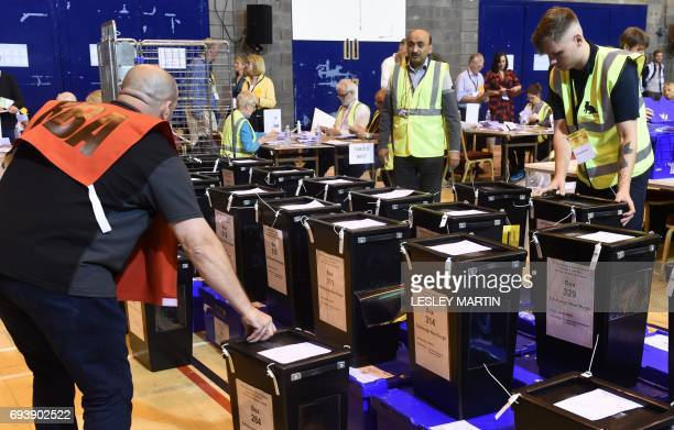 Ballot boxes arrive at the Meadowbank Sports Centre counting centre in Edinburgh Scotland on June 8 after the polls closed in the British general...