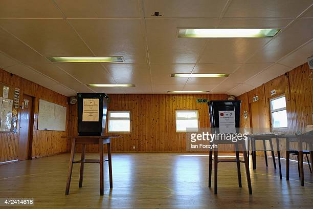 Ballot boxes stand in the centre of a room at a polling station situated inside a scout hut on May 7 2015 in Eston England The nation goes to the...