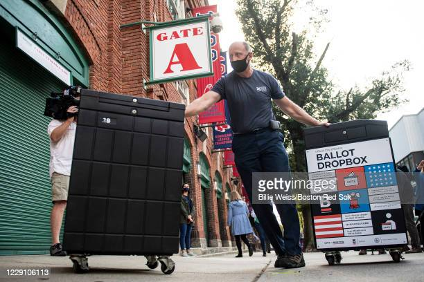 Ballot dropboxes and voting materials are unloaded as the ballpark is prepared to open as an early voting center for residents on October 16, 2020 at...
