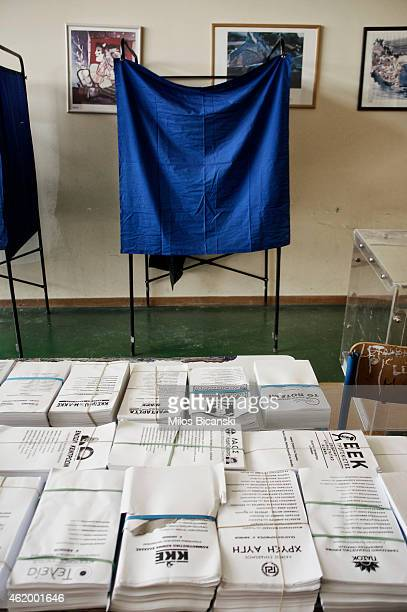 Ballot forms are seen in front of a voting booth at a voting station on January 23 2015 in Athens Greece According to the latest opinion polls the...