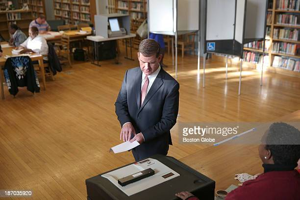 Ballot in hand Rep Marty Walsh voted with his partner Lorrie Higgins and her daughter Lauren Campbell at the Cristo Rey School 100 Savin Hill Ave