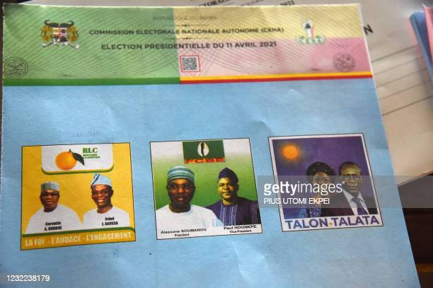 Ballot paper shows photographs of the three Benin presidential candidates and their running mates, at a polling station in Cotonou on April 11, 2021....