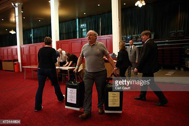Ballot papers are carried into a counting centre on May 7 2015 in Ramsgate England The United Kingdom has gone to the polls to vote for a new...