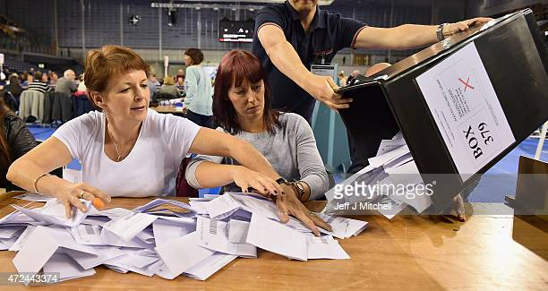 Ballot papers are counted at the Glasgow count for the UK parliamentary elections on May 7 2015 in Glasgow Scotland The United Kingdom has gone to...