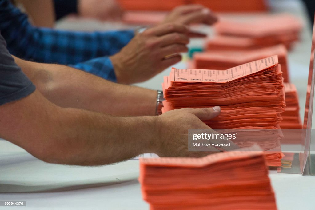 Ballot papers are counted at the Sport Wales National Centre on June 9, 2017 in Cardiff, United Kingdom. After a snap election was called, the United Kingdom went to the polls yesterday following a closely fought election. The results from across the country are being counted and an overall result is expected in the early hours.