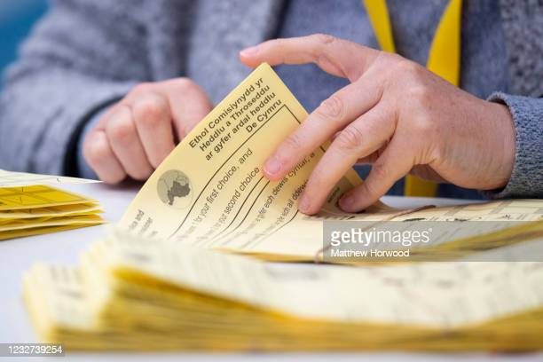 Ballot papers are counted for the Senedd election at the Cardiff House of Sport on May 7, 2021 in Cardiff, Wales. 60 members are to be elected to...