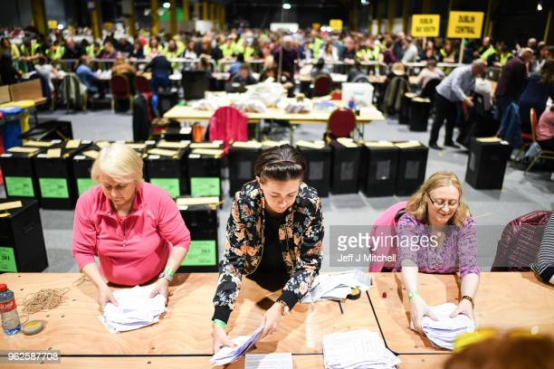 Ballot papers are handled as the count in the Irish referendum on the 8th amendment concerning the country's abortion laws takes place at the RDS...