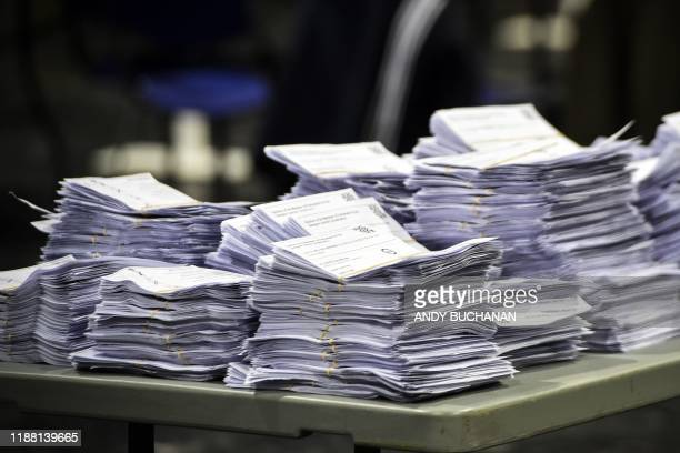 Ballot papers are pictured in stacks in the count centre in Glasgow early in the morning of December 13 2019 as votes are counted as part of the UK...