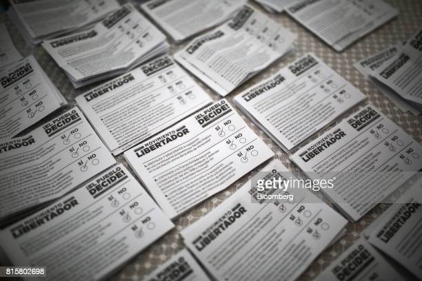 Ballot papers marked 'Si' Spanish for 'Yes' sit in piles for counting during a symbolic Venezuelan plebiscite in Caracas Venezuela on Sunday July 16...