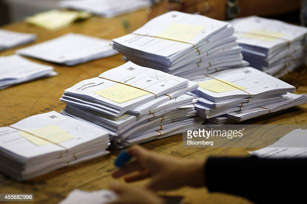 Ballot papers sit stacked in piles on a table during vote counting for the Scottish independence referendum at the Royal Highland Center in Edinburgh...