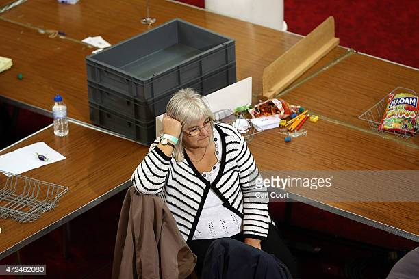 A ballot teller rests during a delay in counting as tellers await ballot papers for the Thanet South constituency on May 8 2015 in Ramsgate England...