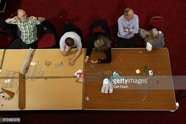 Ballot tellers rest during a delay in counting as tellers await ballot papers for the Thanet South constituency on May 8 2015 in Ramsgate England The...