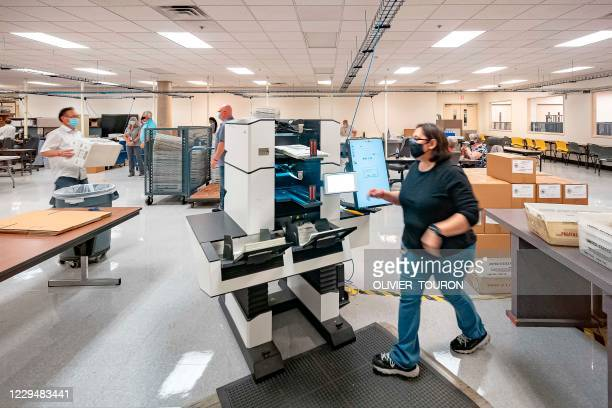 Ballots are counted at the Maricopa County Election Department after the US presidential election in Phoenix, Arizona, on November 5, 2020. -...