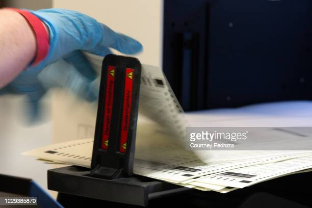 Ballots are counted by Maricopa County Elections Department staff ahead of Tuesdays election on October 31, 2020 in Phoenix, Arizona. Early voting...