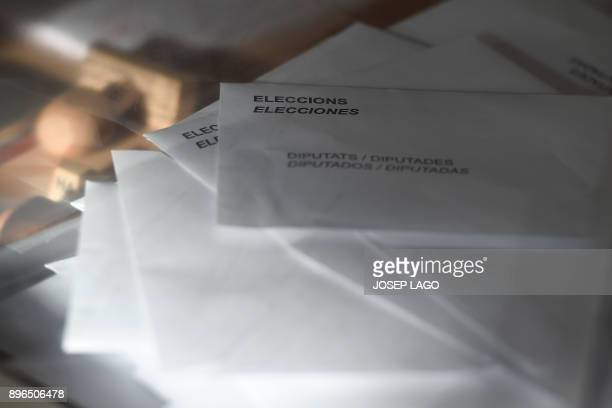 Ballots are pictured in a ballot box at a polling station during the Catalan regional election in Barcelona on December 21 2017 Catalans take their...