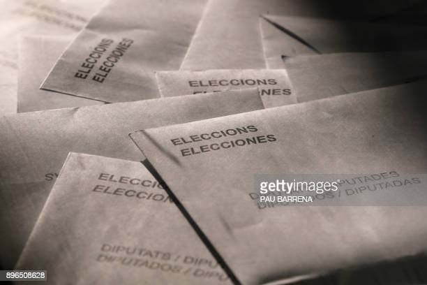 Ballots are pictured in a ballot box during the Catalan regional election at a polling station in Vic on December 21 2017 Catalans take their...