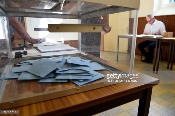 Ballots are pictured inside an urn at a polling station in Authon northern France on June 18 during the second round of the French parliamentary...