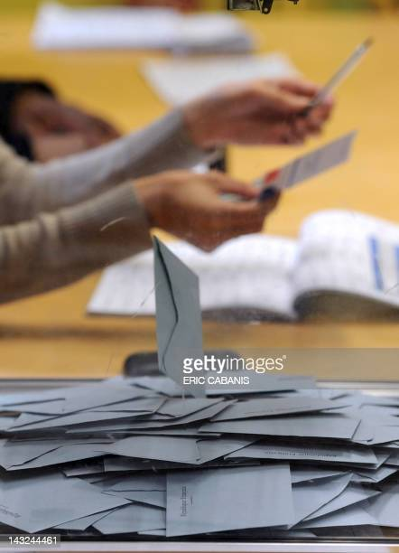 Ballots are put in an urn during the vote for the first round of the French 2012 presidential election at a polling station in the southern city of...