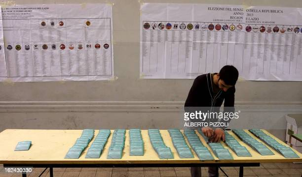 Ballots are readied on February 23 2013 at a polling station in Rome Italians will cast their ballots on February 24 and 25 as they grapple with the...
