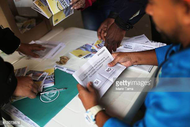 Ballots are sorted in the referendum on a peace accord to end the 52yearold guerrilla war between the FARC and the state on October 2 2016 in Bogota...