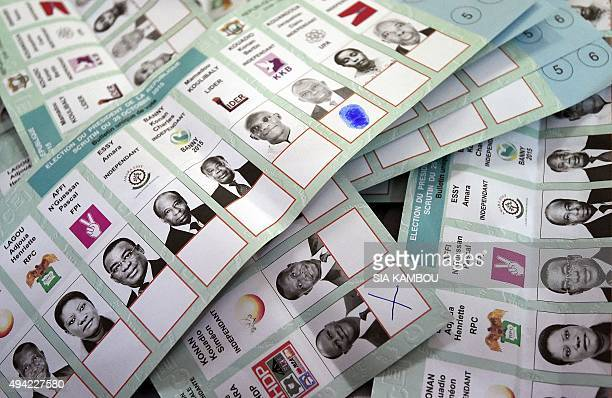 Ballots lie on a table as votes are counted in Abidjan after polls closed in Ivory Coast's presidential election on October 25 2015 Ivory Coast voted...