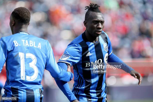 Ballou Tabla and Dominic Oduro of Montreal Impact prepare to defend against a free kick in the second half against the Chicago Fire during an MLS...
