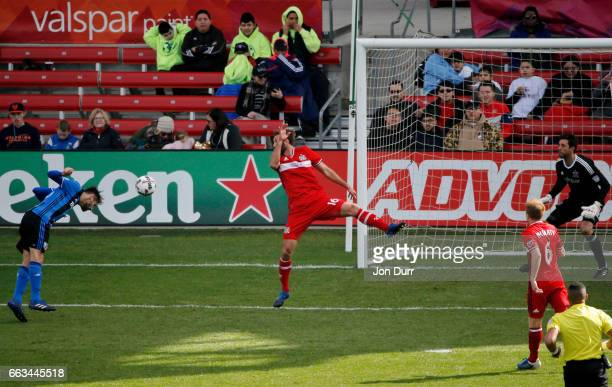Ballou Tabla of Montreal Impact scores a goal as Jonathan Campbell of Chicago Fire is unable to block the shot during second half at Toyota Park on...